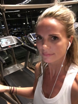 At the gym at the 55th floor, overlooking the skyline of Singapore